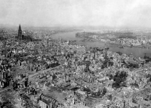 "Cologne, Germany - April, 1945 This mission was the first of 5 to Cologne that Dad did during the War.  Cologne was a military area command HQ during WWII and it endured 262 air raids. This photo shows the devastation.  In the upper left you can see the ""Miracle of Cologne,"" the Cologne Cathedral that suffered minimal damage compared to the rest of the city.  Source:  National Archives."