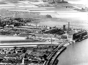 Aerial View of Ford-Werke Plant with Rhine River, Cologne, 1947 So, I was trying to find a reference to Cologne Motor Transport Works online just to learn more about its history. Interestingly enough, all of my searches kept coming back to Ford-Werke in Cologne.  From what I understand, US auto manufacturer Ford had expanded into Germany by the mid-1900's.  In 1939, the name was changed to Ford-Werke and by 1940 it was seized by the Nazi government.  As the war dragged on, forced labor was used at this plant.  Photo Credit: Originally pulled from media.ford.com but original URL no longer exists.